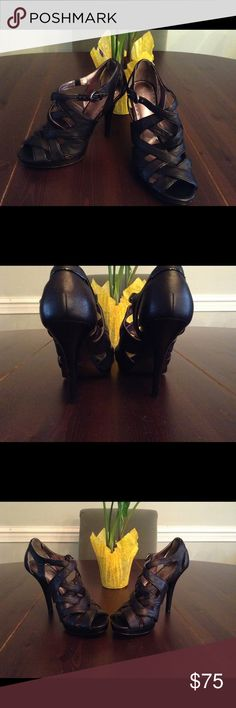 NWTIB Coach black strappy leather heels / sandals Comes with box. Brand new never worn. Coach black leather strappy high heel sandal. 4 1/2 in heel and 1/2 in platform. NWTIB size 8 Coach Shoes Sandals