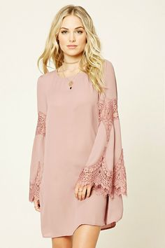 Forever 21 Contemporary - A woven swing dress featuring a long sleeves with floral eyelash lace, round neckline, keyhole back, and a flared hem.