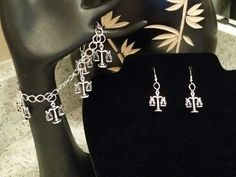 Scales of Justice silver bracelet  and  earrings  set.
