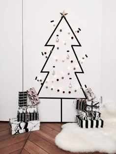 there are ways to make your space feel festive for the holidays without a real Christmas tree. Here, 13 alternative Christmas tree ideas that are both easy and beautiful. Wall Christmas Tree, Black Christmas Trees, Gold Christmas, Xmas Tree, Fir Tree, Christmas Ideas, Scandi Christmas Decorations, Holiday Decor, Deco Tape