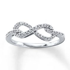 Graceful tendrils of 10K white gold hold a diamond-lined infinity symbol in place as the focal point of this dazzling ring for her. Symbolizing eternal love, the ring has a total diamond weight of 1/5 carat. Diamond Total Carat Weight may range from .18 - .22 carats.