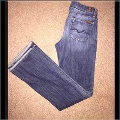 "7 For All Mankind High waist Bootcut jeans Soooo trendy! Authentic 7 for all of mankind high waist bootcut jeans. Size 26. Rise is 9"". Inseam is approx 32 1/2"". A medium wash with fading on the front and back. A bit of distressing on the pockets and zipper. Comfortable fit! Have a slight stretch -- 97% cotton and 3% spandex . Have only been worn a few times and are in perfect condition! Love these so much and hate to sell! Open to reasonable offers no trades / no PayPal! Do not ask! 7 for…"