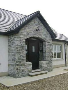 At Sinclair MacCombe Stone Masonry we have extensive experience of building house fronts to your design requirements, we specialise in architectural masonry including flat, round and gothic arches, as well as corbels and natural stone lintels. Bungalow Porch, Bungalow Exterior, Bungalow Renovation, Bungalow House Design, Dormer Bungalow, Grey Stone House, Stone Front House, House Front, Porch Uk