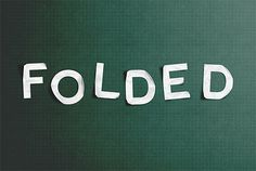 Create a realistic folded paper text in Photoshop