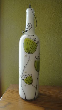 Incense bottle out of wine bottle with fresh lime-green hand-painted flowers. Painted Glass Bottles, Recycled Glass Bottles, Glass Bottle Crafts, Wine Bottle Art, Lighted Wine Bottles, Diy Bottle, Reuse Bottles, Pottery Painting Designs, Hand Painted Wine Glasses