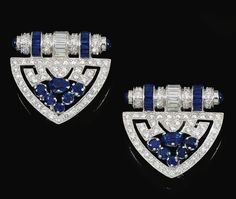 PAIR OF SAPPHIRE AND DIAMOND DRESS CLIPS. Each designed as an open work plaque set with circular-cut and baguette diamonds, embellished with mixed-cut sapphires. Art Deco or Art Deco style.