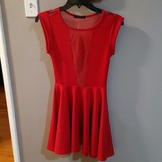 The Vintage Shop Red Dress Cute, red dress. Junior size. It is 92% polyester, 8% spandex and the contrast is 100% nylon. There's a sheer see through V in the top front and an entire sheer see through material on the top back. New. Dresses Mini