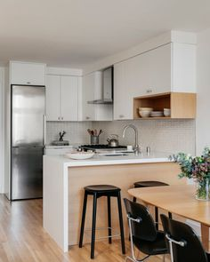 White kitchen tiles in a stylish H-shaped pattern maximize the square footage of this petite kitchen. White Bathroom Tiles, Bathroom Floor Tiles, Kitchen Tiles, Kitchen Decor, Kitchen Design, Petite Kitchen, Timber Shelves, Open Shelves, Pantry Shelving