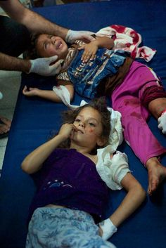 UN School In Gaza Hit -This is what war looks like. Not a meme or hashtag. Innocent children injured and murdered.