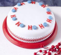 Decorate your cake with classic white icing and marzipan and then top with a playful seasonal motif