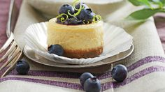 Petite Blueberry Cheesecakes - Top Party Desserts Recipes - Southern Living - Recipe: Petite Blueberry Cheesecakes  As pretty as petits fours, these luscious little two-bite gems can be finished with any kind of berry or preserves. Get ahead, and bake the cheesecakes in advance. After baking, they'll freeze up to one month. Thaw and top with preserves and fruit before serving.