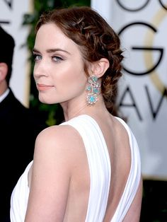 The Best Golden Globes Beauty Looks of 2015: Emily Blunt looked like a fairytale princess in two milkmaid braids that are at once elegant and undone.