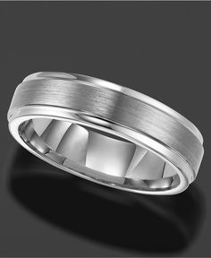 Eternally stylish. This smooth wedding band by Triton is crafted in tungsten carbide. Measuring 6 millimeters wide and made of highly scratch-resistant material, this comfort fit band makes ring-weari