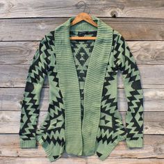 I love this slouchy green sweater. This would look amazing with faux leather leggings and some combat boots
