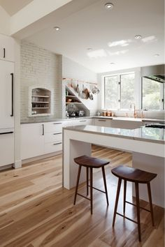 Hickory flooring brings color, interest, and warmth to a modern white kitchen. - Hickory flooring brings color, interest, and warmth to a modern white kitchen. Hickory Flooring, Wide Plank Flooring, Hickory Wood, Wood Flooring, Hardwood Floors, Hickory White, Prefinished Hardwood, Hickory Kitchen, White Oak
