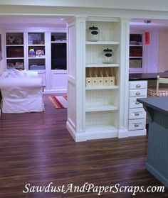 basement remodel - craft room; shelves built around support posts