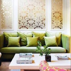 Fancy green, gold, and pink living room