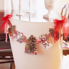 Christmas Card Streamers... Use old Christmas cards to decorate your chairs for the holiday