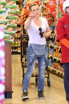 Hilary Duff wearing Golden Goose Distressed Francy Sneakers, Black Orchid Skinny Overalls in Risky Business and Karen Walker Number One Sunglasses