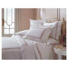 Sateen sheet set with embroidered triple-braid borders.  Product: Twin: 1 Flat sheet, 1 fitted sheet and 1 pillowcase