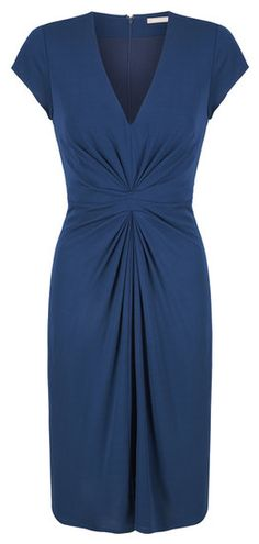 With a similar midsection twist, this jewel-toned blue sheath ($130) is a smart work-ready buy.Photo courtesy of Banana Republic