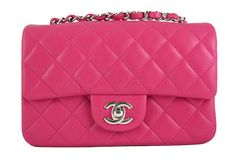 Chanel 2014 Hot Pink Fuchsia Lambskin Mini Flap Crossbody Shoulder Bag - Brand new, unused and in pristine condition. This color is highly sought after and was sold out very quickly. It is from the 2014 spring summer collection. Comes complete with original Chanel box, dust bag, authenticity card and ribbons.