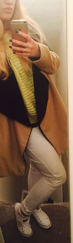 Casual drinks outfit. Lime green jumper with white drinks and asymmetric beige coat wrapping up for winter