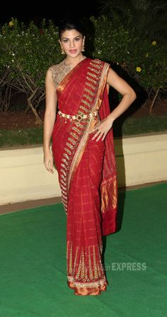 Jacqueline Fernandez was stunning in a red and gold sari with a gold brocade blouse.