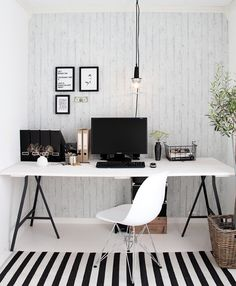 A trestle table is an easy desk solution that creates a big work space. I love the single hanging light and the greenery on the right.