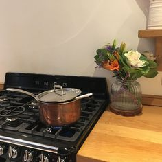 Our beautiful Smeg range cooker and copper pan. Autumnal cabbage flowers.