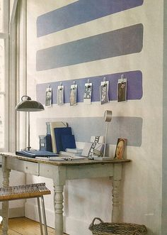 Office wall turned art canvas- why not create an abstract painting on the wall itself?  Restraint is key, and the blues here are marvelous!