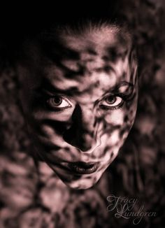 """Creative portraiture -  """"Camouflage"""" The use of light and shadows on a models face. This proved and interesting experiment using various household items to create patterns using a torch."""