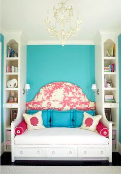 Another possibility...a daybed with narrow bookcases built into both sides. Love the wall sconces on the sides.