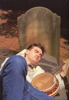 Morrissey of The Smiths at Brompton Road Cemetery, London, England ― photo by Lawrence Watson (1985).