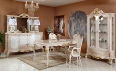 Tamamen doğal ahşaptan uzun uğraşlar sonucu el işçiliği ile üretilen klasik yemek odası takımı, konsol, ayna, masa, iki adet kollu sandalye, altı adet kolsuz sandalye ve vitrinden oluşuyor. http://www.asortie.com/yemek-odasi-215-Elif-Klasik-Yemek-Odasi