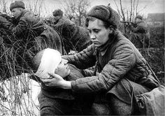 Russian nurse helping wounded soldier