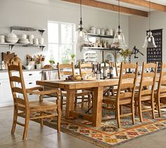 Benchwright Extending Dining Table | Pottery Barn  Large seats up to 12 (more with bench seating on one side) $