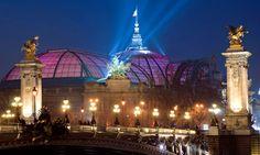 Paris's illuminated Grand Palais, behind the Alexander III Bridge. Photograph: Alamy