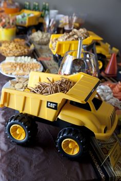 Use trucks as serving platters--how cute is this? For a little boy's birthday party    obviously might want to by new ones that are clean and scrub but cool idea!    My only fear is considering the boys I know, the pretzels etc would end up dumped on the table! Who can resist dumping a dump truck that has something in it!!! @Cait Unites Longton