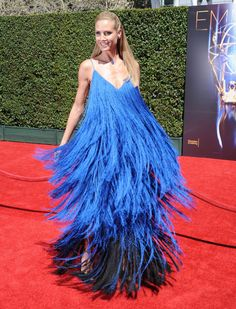 Heidi Klum in '70s-inspired dress custom made by Project Runway contestant Sean Kelly.