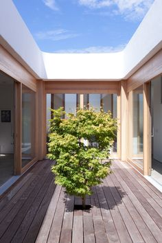 new prefab home, the Tatami House, designed by Swiss architect Roger Kurath of Design*21, makes a central courtyard
