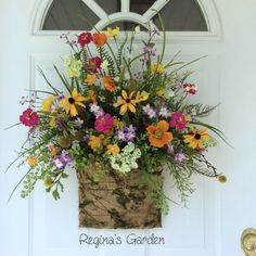 "I love the ""just picked from the garden"" look of this floral basket design."