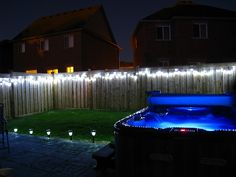 String lights along your fence for backyard lighting.Gotta be careful of my freak neighbors electric fencing he has on top of our fence. Fence Lighting, Backyard Lighting, Exterior Lighting, Outdoor Lighting, Outdoor Decor, Lighting Ideas, Rustic Outdoor, Backyard Paradise, Backyard Retreat