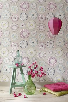 A quirky wallpaper design with decorative coloured porcelain plates