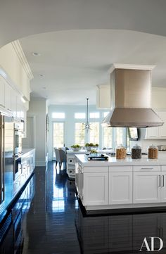 A large kitchen island creates room to entertain and cook in the California kitchen of Khloé Kardashian. | archdigest.com