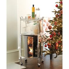 """Stella Bar Cart, $499, 39.5""""h x 20.75""""w x 15""""d, polished stainless steel and glass"""