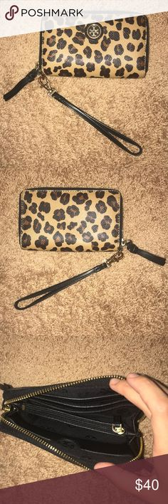 Tory Burch Wristlet Wallet in Cheetah Print Tory Burch Cheetah Print Wristlet/Wallet. Lightly used. Gold hardware is lightly tarnished, as seen in the pictures. Tory Burch Bags Wallets