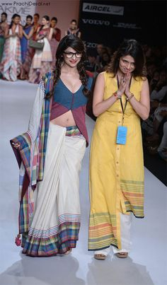 Sporting a bespectacled look with her hair made into two plats and clad in a specially hand-woven saree by Shruti Sancheti, actress Prachi Desai rocked the de-glam look on the ramp at Lakme Fashion Week. Cotton Saree Designs, Saree Blouse Neck Designs, Fancy Blouse Designs, Simple Kurta Designs, Latest Indian Fashion Trends, Prachi Desai, Bollywood Designer Sarees, Embroidery Suits Design, Stylish Blouse Design