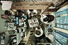 hong kong flats: A group of people eating in their cramped flat.