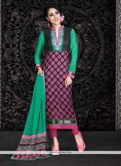 Be the sunshine of anyone's eyes dressed in this pink and sea green faux crepe churidar designer suit. The fantastic dress creates a dramatic canvas with unbelievable embroidered and lace work. Come...